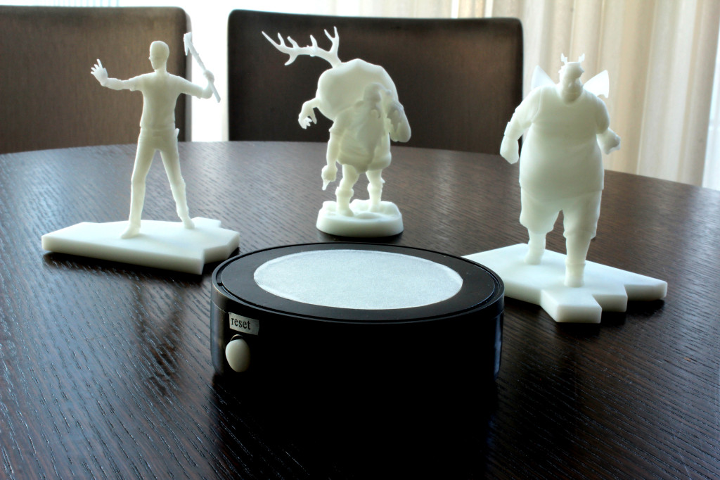 NFC touchstone bluetooth device and 3 zombie 3d printed sla figures non painted white