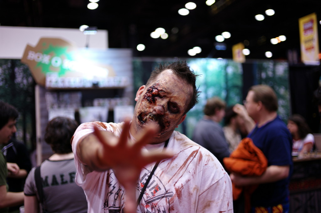Zombie cosplay in from of the box o zombies booth at c2e2 2013