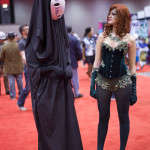 poison ivy cosplay looks confused at weird face mask at c2e2 box o zombies booth
